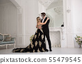 Couple with dark skull makeup on white background. 55479545