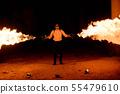 Halloween man in costume with flamethrower 55479610