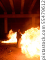 Halloween couple standing with flamethrower. 55479612