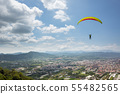 colorful paragliding over blue sky at town 55482565