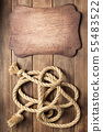 sign board and ship rope at wooden background 55483522