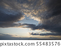 Dramatic sky in the rays of the setting sun. 55483576