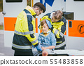 Boy is injured after accident, medics taking care of him 55483858