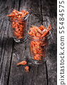 Shrimps in glass tumbler on wooden background. 55484575