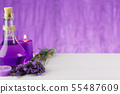 Spa products, aroma candle and lavender flowers on 55487609