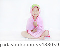 Happy little Asian child girl smiling under towel 55488059