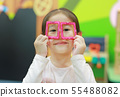 Little child girl playing Magnets toy for brain 55488082