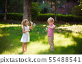 Kid and friends play a bubble in playground 55488541
