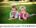 Two young boys walk and relax in the park. 55488660