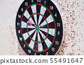 Dartboard with darts 55491647