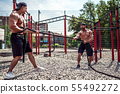 Men work hard with rope at street gym yard. Strength and motivation. Outdoor workout. fitness, sport 55492272