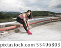 Asian female sport fitness runner getting ready 55496803