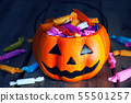 Pumpkin decorate with candy on wood table and dark 55501257