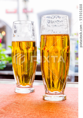 Two glasses of fresh beer on the table 55501888