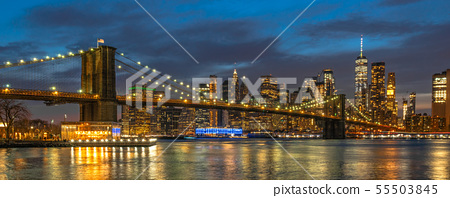 Banner and cover scene of New york Cityscape with Brooklyn Bridge over the east river at the twilight time, USA downtown skyline, Architecture and transportation concept 55503845