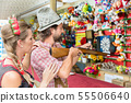 Couple on Bavarian fair at the shooting gallery 55506640