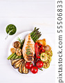 Grilled chicken breast on a plate with grill vegetables on a wooden background, flat lay 55506833