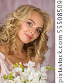 beautiful curly blonde bride in gorgeous pink dress 55508509