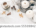 Autumn breakfast in bed composition. Cup of coffee on wooden board, white pumpkins, sweater, oak 55509842