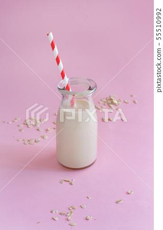 Vegan oat milk, non dairy alternative milk 55510992