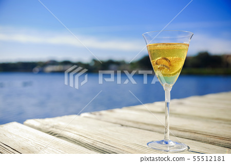 wedding rings inside a glass with champagne symbol 55512181