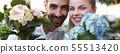 Two Gardeners Showing Hydrangea Flower Portrait 55513420