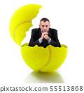 man sitting in a tennis ball 55513868