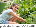 smiling young girl working in the kitchen garden 55515481