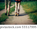 Asian couple is camping and walking along the road 55517995