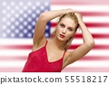 pretty young blond woman the American flag in 55518217