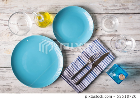 table setting coordinated in blue and white 55518720
