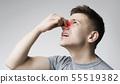 Young man touching his bleeding nose, panorama 55519382