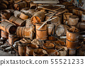 Old and damaged wine and beer barrels 55521233