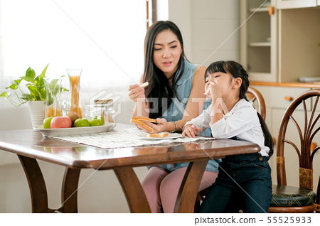 Asian little girl enjoy with bread eating 55525933
