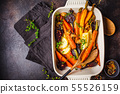 Baked vegetables with thyme in the oven dish 55526159