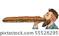 man eats a long sandwich 55526295