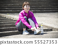 Woman wearing outdoor sports shoes 55527353