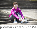 Woman wearing outdoor sports shoes 55527356