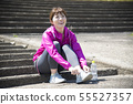 Woman wearing outdoor sports shoes 55527357