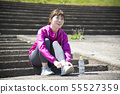 Woman wearing outdoor sports shoes 55527359