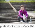 Woman wearing outdoor sports shoes 55527361