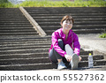 Woman wearing outdoor sports shoes 55527362