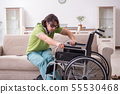Young male student in wheelchair at home 55530468