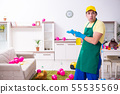 Young male contractor doing housework after party 55535569