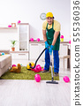 Young male contractor doing housework after party 55536036