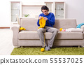 Young good looking man knitting at home 55537025