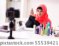 Beauty blogger in hijab recording video for her blog 55539421