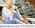 Blonde young girl  looking side, sitting on home 55540281