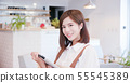 woman use pad to order 55545389