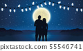romantic night couple in love at the sea with full moon and fairy lights 55546741
